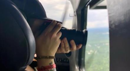 photographer taking picture in the plane